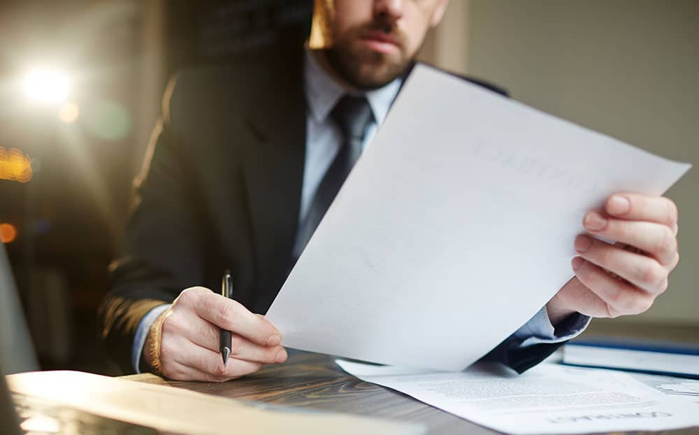 A person reading a lease agreement